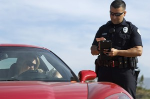 http://www.dreamstime.com/stock-photos-traffic-cop-sports-car-image29660073