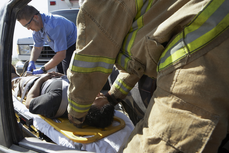 http://www.dreamstime.com/stock-photography-firefighter-paramedics-helping-car-crash-victim-image29660142